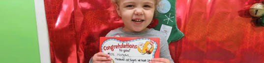 Child holding certificate
