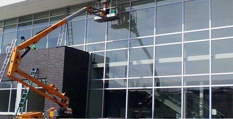 Window cleaners working on outside of building