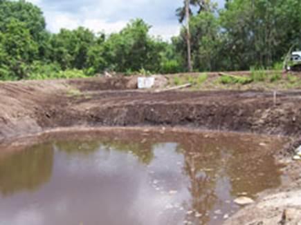 Retention pond site development panama city fl for Pond drain design
