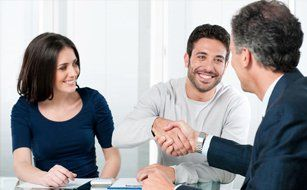 Couple discussing with insurance agent