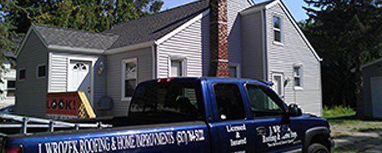 J. Wrozek Roofing & Home Service  Truck