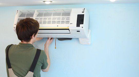 Installs air conditioner