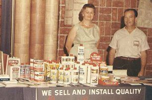 vintage photo of original owners at a trade show with products on a folding table