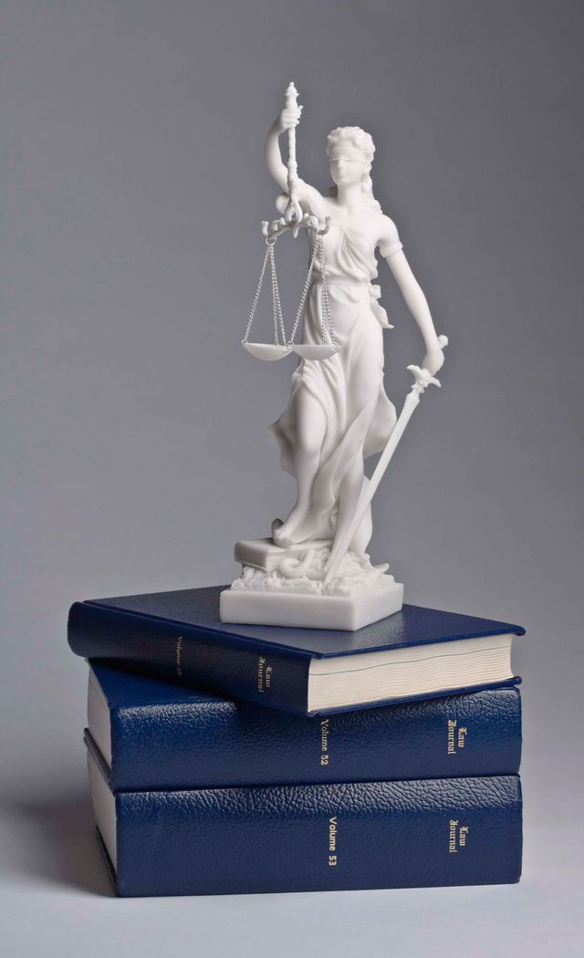 Law book and statue