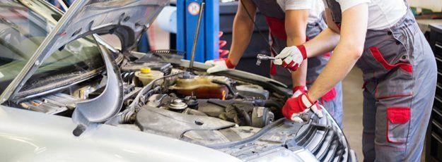 Mechanics checking engine