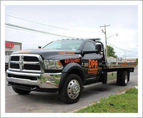 Deer Park Auto Body shop towing truck
