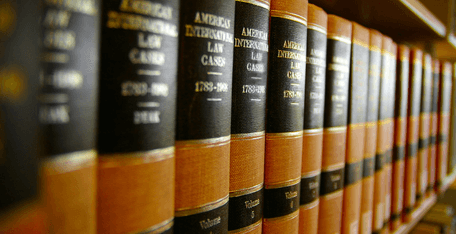 close up of a collect of case law books on a shelf