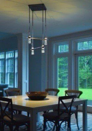 Modern light fixture over dining room table