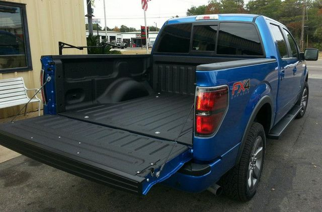 Line-X Premium Sprayed on Grill, Lower Rocker Panels, and Roof