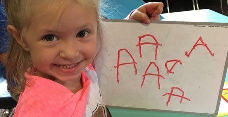 Child showing writing