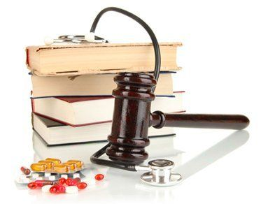 Gavel and medical books