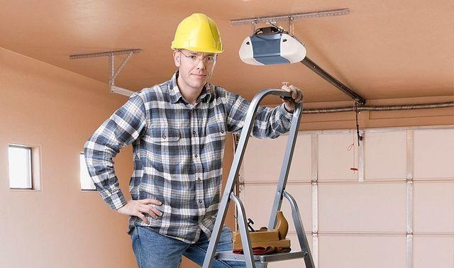 Man Just Finished Repairing The Garage Door Opener