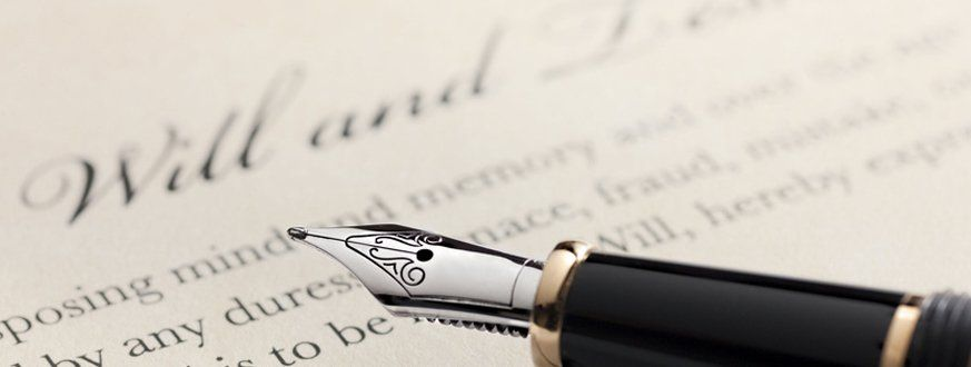 Will and testament and a pen