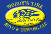 Woody's Tire Auto & Towing LLC - Logo