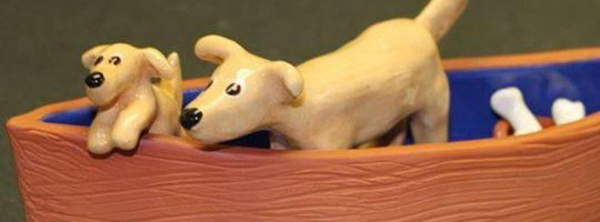 Lori Rottenberg Clay Dogs in a Boat