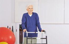 old woman using walker