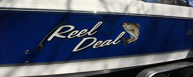 Reel Deal boat lettering made by Sign It!