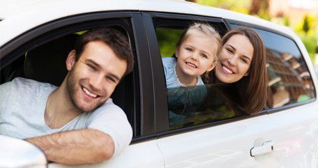 family riding on car