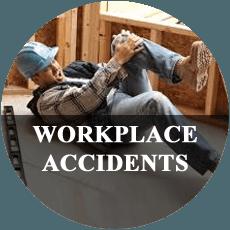 Fallen construction worker holding his injured knee