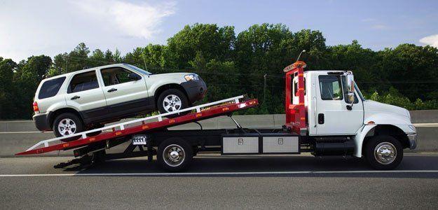 SUV being towed