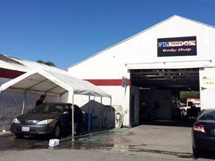 Freedom Body Shop exterior with car wash port