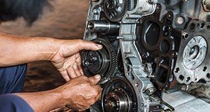 Mechanic repairing engine