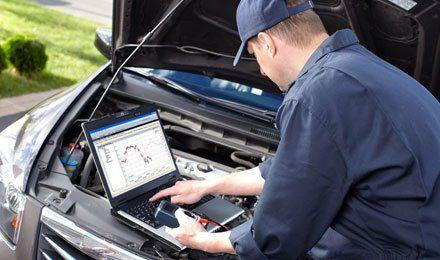 man conducting car diagnostics