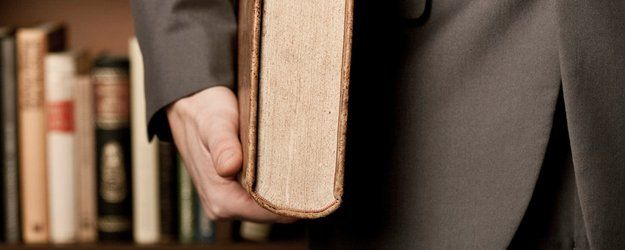 lawyer holding a book