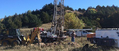 Workers drilling