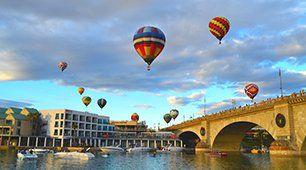 hot air balloons above lake