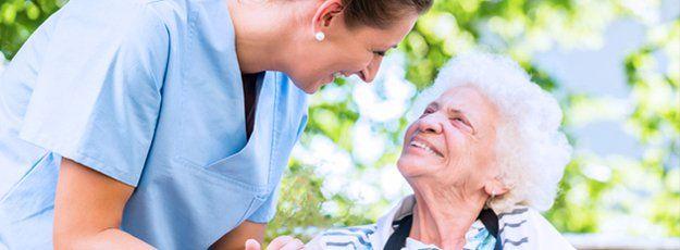 Happy caregiver and an elder