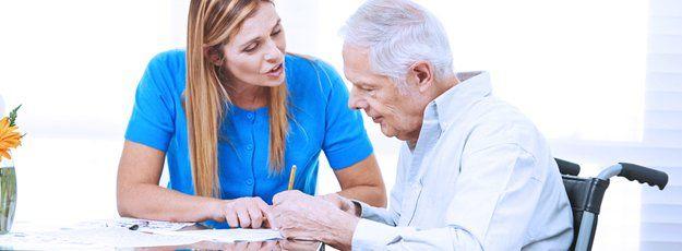 Caregiver talking to an elder