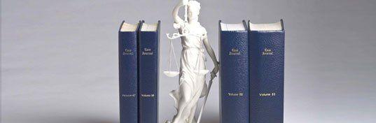 Law books and statuette