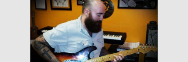 teacher Patrick Goble with electric guitar