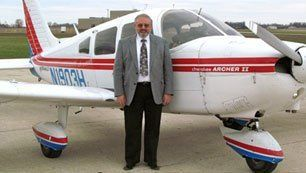 attorney beside a plane