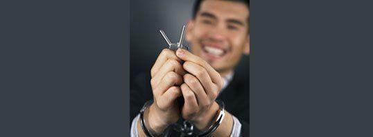 Hand cuff release