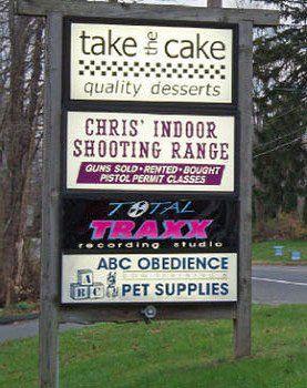 Chris Indoor Range & Gun Shop sign board