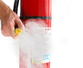 close-up of fire Extinguisher being triggered