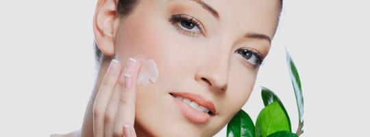 Woman Applying Skin Cream