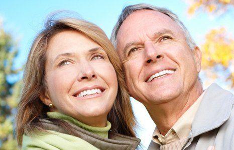 Smiling elder couple