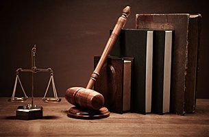 Justice scale, gavel and legal books