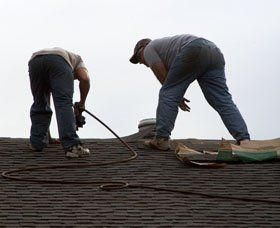 two men on roof