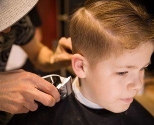 Portrait of male child at the barber shop to cut his hair