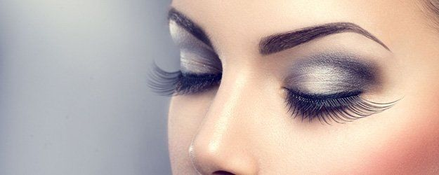 beautiful woman with long eyelash extensions