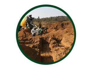 Men working digging trenches