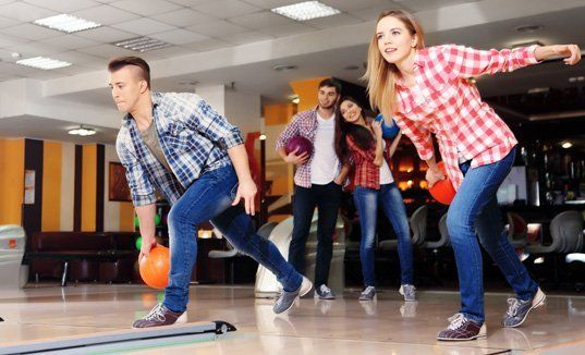 Young adult bowlers