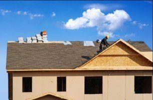 Man applying roof felt