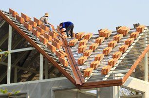 Two man installing new tile roof