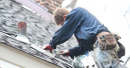 Man repairing the roof
