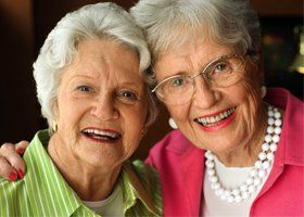 Two elder women smiling